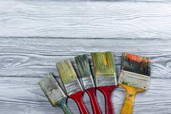 Artistic, artist, art. Used artist paintbrushes mastehin on wood background - stock photo