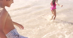 Stock Video Footage of Cute siblings playing on the beach