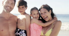 Portrait of happy family at the beach - stock footage