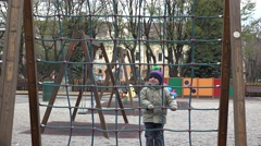 Sweet lovely child climbing at playground, outdoor activities  Stock Footage