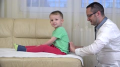 Young doctor consulting happy child, friendly doctor Arkistovideo