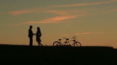 Romantic Couple with Tandem Bicycles Softly Kissing While Sunset. Summer Nature Stock Footage