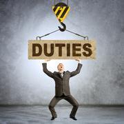 Businessman holding heavy word duties Stock Photos
