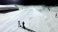Winter sports at night in the mountain. Aerial.Slow motion Stock Footage