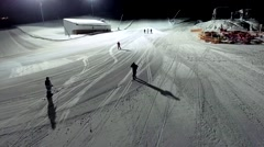 Winter sport at night in the mountains of Georgia. Aerial view. Slow motion Stock Footage