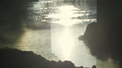 Morning vapors from the river in slow motion with silhouettes of rocks Stock Footage