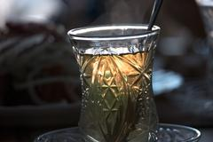 Turkish tea with reverse light (backlit) image during the sunset in dark room Stock Photos