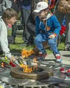 The coins laying at the eternal flame in honor of the 70 anniver - stock photo