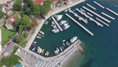 Ships, boats and yachts tied to a floating dock in the marina next to the beach. Stock Footage
