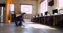 Designer Plans Layout On Floor Of Modern Office Shot On R3D - stock footage