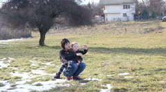 Early spring sunny weather selfie shot mother and a child Stock Footage