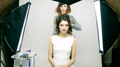 Makeup applying. White dress Stock Footage
