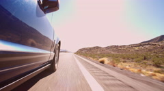 Low Angle View Of Car Driving Along Country Road Shot On R3D Stock Footage
