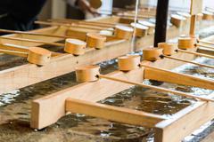Bamboo Japanese purification ladle at entrance of Japanese Temple - stock photo