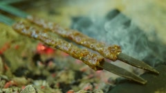 Barbecue grilling shish kebab slow motion Stock Footage