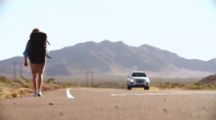 Two Men On Vacation Hitchhiking Along Road Shot On R3D Stock Footage
