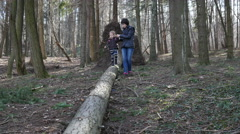 Mother walking with little daughter kid in nature forest park - stock footage