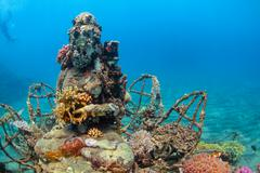 Underwater Buddha statue with diving snorkeler on the background0122 Stock Photos