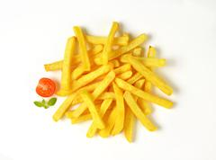Heap of French fries on white background Stock Photos