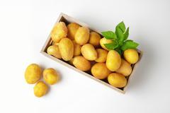 box of raw unpeeled potatoes - stock photo