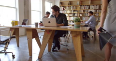 Businesspeople Working At Desks In Busy Office Shot On R3D Stock Footage