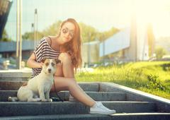 Trendy Hipster Girl with her Dog in the City - stock photo