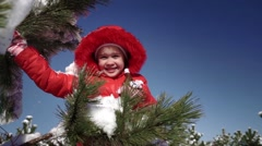 Little girl playing with snowballs Stock Footage