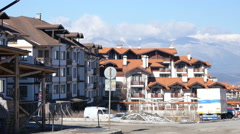 Hotel buildings in winter ski resort Bansko in Bulgaria Stock Footage