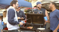 Slow Motion Shot Of Sports Fans Tailgating In Parking Lot Stock Footage
