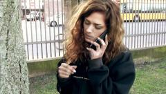 A Junky Girl talking to a drug dealer on a phone Stock Footage