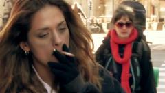 A Junky Girl Walking in Crowded Street  Stock Footage