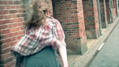 A man running away from someone in a street Stock Footage