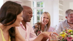 Mature Friends Around Table At Dinner Party Shot On R3D Stock Footage