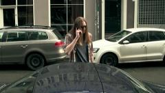 A man Talks on the phone in front of his car Stock Footage