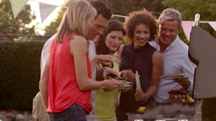 Mature Friends Enjoying Outdoor Barbeque Shot On R3D Stock Footage