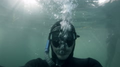 Freediving Drowning and Sinking deep under Water. Stock Footage