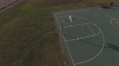Empty outdoor basketball court pan aerial view 4k Stock Footage