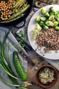 Healthy meal: Chickpeas, buckwheat, okra - stock photo