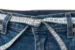 Waist check and excess weight control concept - stock photo