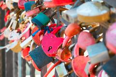 Many marriage love symbol padlocks chained on bridge in Astrakhan Russia Stock Photos