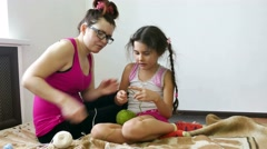 Woman and teen girl knitting knit needlework lifestyle Stock Footage