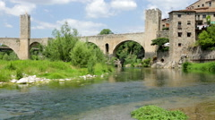 Medieval town with gate on bridge. Besalu, Catalonia Stock Footage