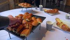 French bakery, croissant, pain au chocolat on table in business meeting 2 Stock Footage