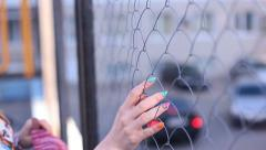 Girl rabitz fence city Stock Footage