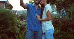 Happy couple taking selfie in the garden Stock Footage
