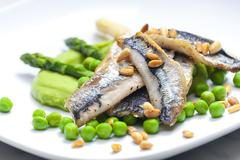 herring with green asparagus and peas - stock photo