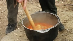 Cooking Traditional hungarian dish - bogracs goulash Stock Footage