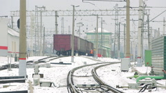 Freight train at the railway station in the winter Stock Footage