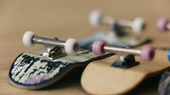 Several fingerboards lie on a wooden table Stock Footage