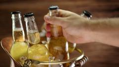 Man's hand taking a bottle of cold beer. Stock Footage